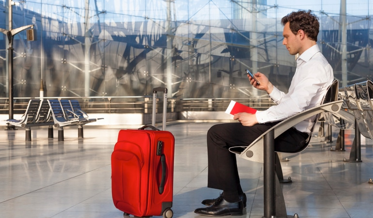 Traveling man is sitting on a bank ready for thrombosis prophylaxis